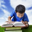 Boy practice reading outdoor — Stockfoto