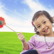 Little girl with red gerbera — Stock Photo #10744881