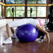 Woman excercising with swiss ball — Stock Photo