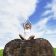 Young woman meditating outdoor — Stock Photo #10745898