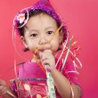 Cute girl blowing party horn — Foto de Stock
