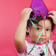 Cute girl wearing a party cap — Stock Photo #10988392