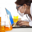 Lab assistant works with laptop — Stock Photo #10989695