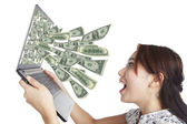 Money from laptop — Stock Photo