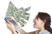 Peníze z notebooku — Stock fotografie