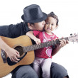 Musician with his daughter — 图库照片