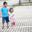 Siblings on parking lot — Foto Stock