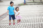 Siblings on parking lot — Stock Photo