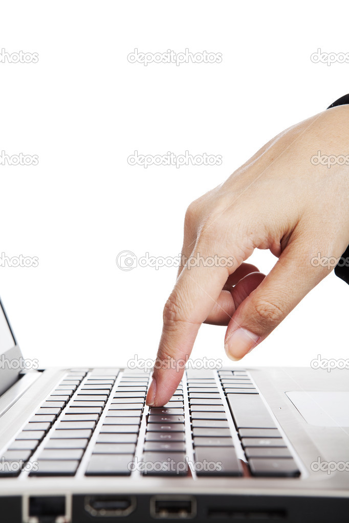 Human finger pressing button on laptop computer — Stock Photo #10990369