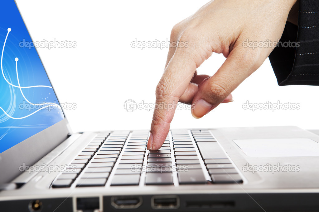 Closeup of a finger pressing a button of laptop computer keyboard — Stock Photo #11061685