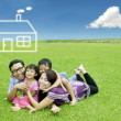Asian family with dream house — Stock Photo