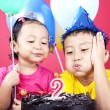 Asian kids celebrating birthday — Stock Photo