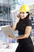 Attractive female architect at workplace — Stock Photo