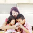 Mother and children in kitchen — Stock Photo