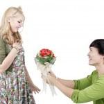 Romantic man giving flowers — Stock Photo