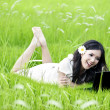 Woman with laptop in nature — Stock Photo