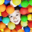 Cheerful boy with colorful balls — Zdjęcie stockowe
