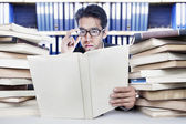 Analyzing business books — Stock Photo