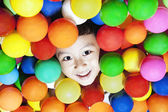 Cheerful boy with colorful balls — Stock Photo