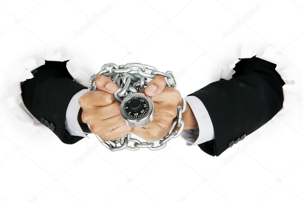 Businessman hand handcuffed by padlock and chain, can be used as symbol a suspect of illegal business  Stock Photo #11485769