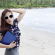 Businesswoman posing at beach — Stock Photo