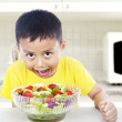 Hunger child eats salad — Stock Photo #11635680