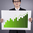 Businessman with green business statistics — Stock Photo #11635975