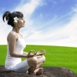 Meditating by the meadow — Stock Photo #11788647