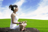 Meditating by the meadow — Stock Photo