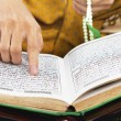 Reading al-quran - Stock Photo