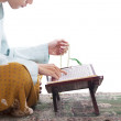 Stock Photo: AsiMuslim reading Korin Ramadan