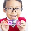 Schoolboy with SALE word — Stock Photo #11993584