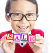 Schoolboy with SALE word — Stockfoto