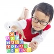 Schoolboy with alphabet blocks — Stock Photo