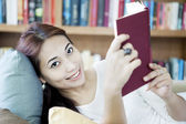 Smiling woman reading book — Stock Photo