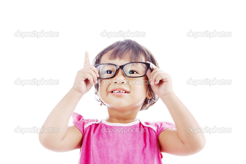 Portrait of asian female preschooler wearing glasses and rises her finger. shot in studio isolated on white — Stock Photo #12007983