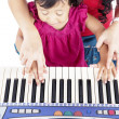 Learning how to play piano — Stock Photo