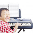 Stock Photo: Little piano player