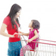 Mother laughing with daughter on trolley — Stock Photo