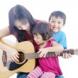 Musician with her children — Stock Photo