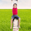 Pupil with books outdoor — Stock Photo #12070811