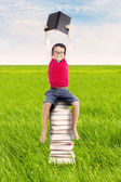 Pupil with books outdoor — Stock Photo