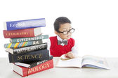 Pupil studying by reading books — Stock Photo