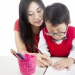 Learning to write with mother — Stock Photo
