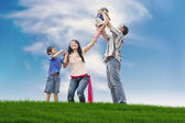 Happy family on the meadow — Stock Photo