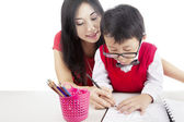 Learning to write with mother — Stockfoto