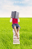 Reading book outdoor — Stockfoto