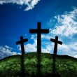 Silhouette of three crosses on a hill - Stock Photo