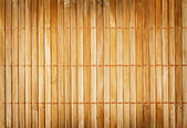 Wall from the tied up wooden planks — Stock Photo