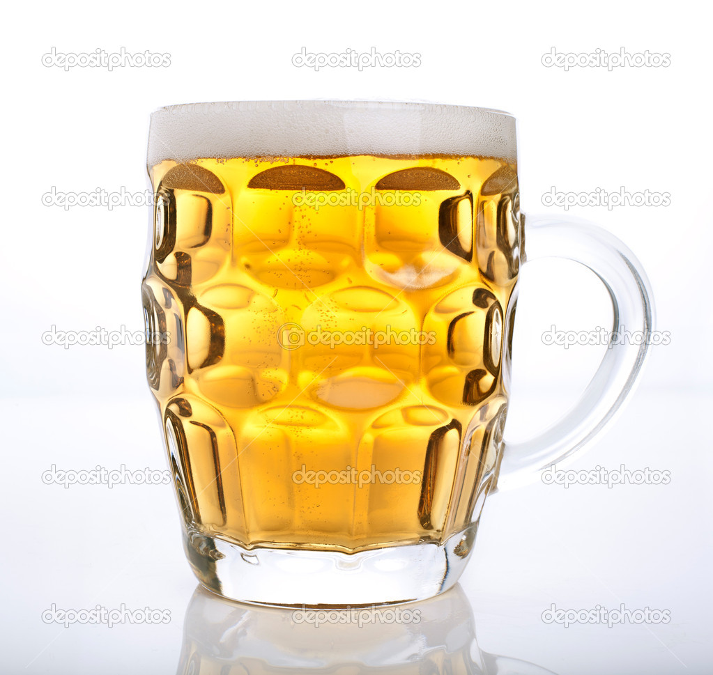 Mug of beer isolated on white  Stock Photo #10991792
